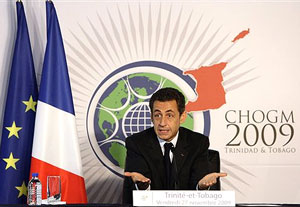 French President Nicolas Sarkozy gestures at a news conference held during the Commonwealth Heads of Government meeting (CHOGM) in Port-of-Spain on Friday. AP