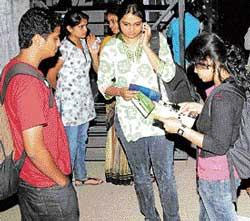 Students come out after appearing for CAT online at a centre in Bangalore on Saturday. DH Photo