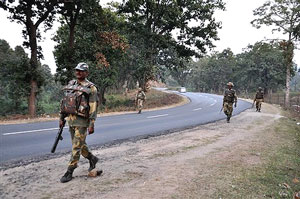 Border Security Force(BSF) jawans patrol the NH-33 near Ranchi on Saturday on the eve of Maoists' proposed 48-hours state bandh against Operation Green Hunt. PTI