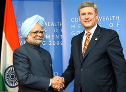 Prime Minister Manmohan Singh shakes hands with his Canadian counterpart Stephen Harper at a meeting in Port of Spain, Trinidad, on Saturday. PTI