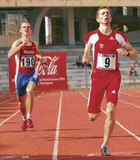 Matzinger Gunther of Austria (right) wins the men's 400M (T-46) gold from Yury Nosulenko of Russia at the IWAS Games in Bangalore on Monday. DH photo