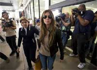 Rachel Uchitel arrives from New York at the Los Angeles International Airport in Los Angeles. The National Enquirer published a story alleging that golfer Tiger Woods, who was involved in a car accident near his home on Friday, had been seeing the New York night club hostess, and that they recently were together in Melbourne, where Woods competed in the Australian Masters. Uchitel denied having an affair with Woods when contacted by AP.