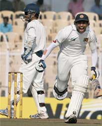 Lankan batsman Tilakratne Dilshan celebrates after completing a century. AP
