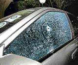 In this December 28, 2005, file photo a bullet-riddled car is seen inside the Indian Institute of Science premises following an attack by unknown gunmen. DH photo