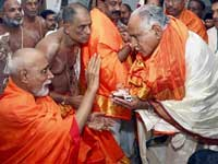 Karnataka CM BS Yeddyurappa being blessed by the head pontiff at the Sri Raghavendra Swamy Mutt recently (AP)