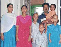 Ekramul and Ali Hussain with their family members.