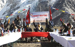 on Top of the world : Nepalese politicians take part in a cabinet meeting at Kalapattar Plateau near Mount Everest, at an altitude of 5,262 metres, on Friday. AFP