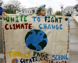 Arundhati Baden-Mayer Eidinger, 5, of Washington holds up banners calling for actions on climate change, Friday, Dec. 4, 2009, in front of the White House in Washington. The UN climate conference that begins Monday in Copenhagen. AP