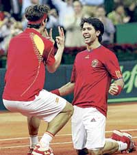 Spain's Feliciano Lopez (left) and Fernando Verdasco celebrate their doubles win over Czech Republic's Tomas Berdych and Radek Stepanek on Saturday. AFP