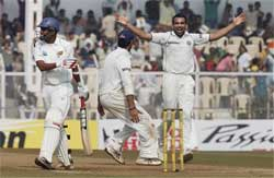 Zaheer Khan celebrates the dismissal of Thilan Samarveera (L) on the fourth day of the final test against Sri Lanka in Mumbai on Saturday. PTI