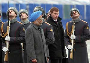 Prime Minister Manmohan Singh reviews the honor guards shortly after his arrival at Vnukovo II airport outside Moscow on Sunday. PTI