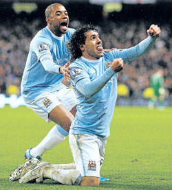 Manchester City's Argentine striker Carlos Tevez celebrates scoring a goal against Chelsea with team-mate Robinho (left) on Sunday. Reuters