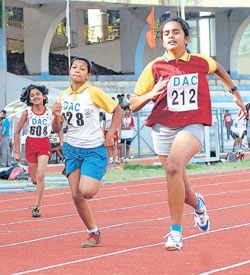 The Brigade School's Jaya Nanthini J (right) en route to winning the 100M gold in the girls under-12 category at the Deccan Athletic Club meet on Sunday. DH Photo