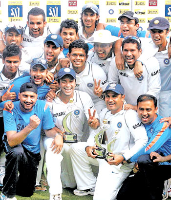 Team India poses for photos after the third Test against Sri Lankans and reaching the first spot in Mumbai on Sunday. PTI