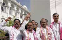 TRS MLAs shout slogans during a demonstration demanding separate statehood for Telangana outside the Andhra Pradesh legislative assembly in Hyderabad on Tuesday. PTI Photo