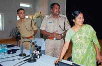 District Information Officer Rohini K launching the DK police website at SP office in Mangalore on Wednesday. SP Dr A Subramanyeshwar Rao and ASP Amit Singh look on.