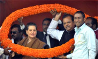 Congress president Sonia Gandhi along with party leader and Union Minister Subodh Kant Sahay during an election campiagn rally. AP