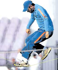 Indian captain Mahendra Singh Dhoni during a training session on Tuesday at Nagpur. AP