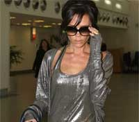 Victoria Beckham arrives at Heathrow Airport, London after a flight from Los Angeles on Tuesday. AP
