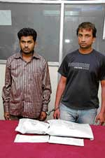 Shafiulla and Premachandra, who were arrested by the CCB sleuths for carrying brown sugar.