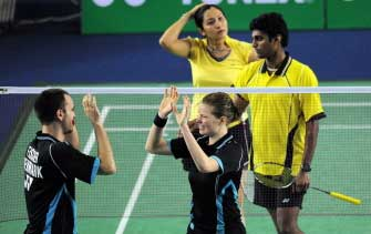Joachim Fischer Nielsen and Christinna Pedersen (R-front) of Denmark celebrate as Indians Valiyaveetil Diju and Jwala Gutta (R-top) look dejected at the end of their mixed-doubles final at the Badminton World Super Series Masters finals in Malaysia's Johor Bahru on Dec 6, 2009. AFP