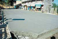 The concretisation work in progress on Madikeri Private Bus Stand - Mangerira Muthanna Circle stretch in Madikeri. dh photo