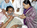 TRS president K Chandrashekar Rao's wife offer him juice to break his hunger strike at NIMS in Hyderabad on Wednesday night. PTI