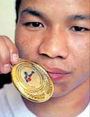 Suranjoy bags gold in style