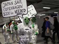 Environmentalists stage a protest with a banner reading 'Japan save Copenhagen $200 bn needed' at the UN Climate Summit in Copenhagen, Denmark, Thursday. AP