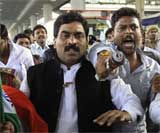 Supporters shout slogans as police arrest Congress MP L Rajagopal in Hyderabad on Monday. AP