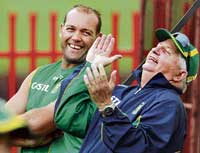 ALL SMILES: South Africa's Jacques Kallis (left) and coaching consultant Duncan Fletcher during a training session. REUTERS