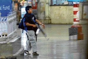 caught in action: In this file photo taken on November 26, 2008, Mohammed Ajmal Kasab, the accused gunman walks at the Chatrapathi Sivaji Terminal railway station in Mumbai. PTI/ Courtesy Mumbai Mirror