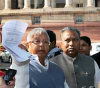 RJD chief Lalu Prasad Yadav along with party leader P C Gupta showing a paper while to the media regarding Railways Minister Mamata Banerjee's tabling of White Paper in the Lok Sabha, at Parliament House (PTI)