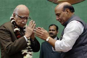 BJP President Rajnath Singh greets senior leader L K Advani after he was elected as the Chairman of BJP Parliamentary Party in New Delhi (PTI)
