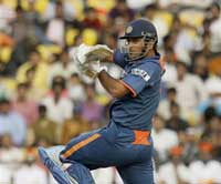Indian cricket captain Mahendra Singh Dhoni plays a shot enroot to his century at Nagpur in the second ODI aganist SL (AP)