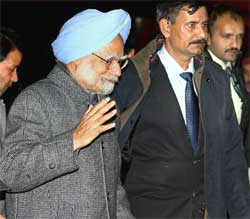 Prime Minister Manmohan Singh arrives at Copenhagen Airport on Thursday night. PTI