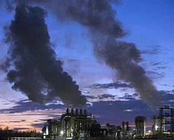 Smoke billows from the chimneys of a wood products factory near the city of Burgos, northern Spain. File photo/ Reuters