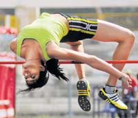 Mighty leap: Sahana Kumari of South Western Railway en route to her high jump gold on Saturday. DH Photo