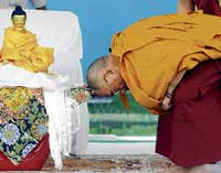 OBEISANCE Tibetan spiritual leader Dalai Lama prostrates in front of the statue of Buddha. He arrived in the City on Saturday to commemorate the first anniversary of Buddha Vihara, on the outskirts of Gulbarga. DH Photo
