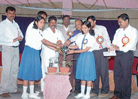 Zilla Panchayat President V M Vijaya inaugurating students: scientists interaction programme by watering a plant. DH photo
