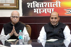 BJP senior leader L K Advani with outgoing BJP President Rajnath Singh at Parliamentary Board meeting at party office in New Delhi on Saturday. PTI