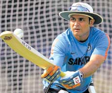 Eyes on the ball: Stand-in skipper Virender Sehwag in experimental mode during Sunday's practice session at the Barabati stadium in Cuttack. AP
