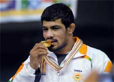 Indian wrestler and Olympic bronze medallist Sushil Kumar in jubilant mood after winning the gold medal in the Commonwealth Wrestling Championship in Jalandhar on Sunday. PTI Photo