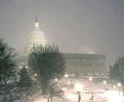 The US Capitol is seen during the snow storm as the health care debate continues in the Senate into the evening on Capitol Hill in Washington on Saturday. AP