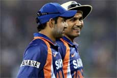 Virendra Sehwag smiles as he walk to pavilion with Gautam Gambhir at the end of Sri Lankan innings during the 3rd ODI match at Barabati Stadium in Cuttack on Monday. PTI Photo