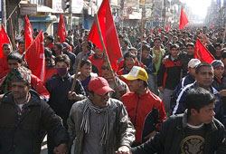 Nepal's Maoist supporters march the streets on the second day of the three-day strike in Katmandu, Nepal on Monday. AP