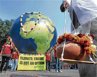 Dead deal: Greenpeace activists stage a simulated funeral procession of the Earth after the end of the Copenhagen Conference on Climate Change failed to come up with a legally binding treaty, at Jantar Mantar in New Delhi on Monday. PTI