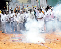 JD(S) and Congress workers celebrate after the announcement of the Council poll results in Bangalore on Monday.  KPN