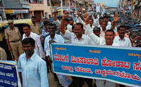 Madiga Meesalathi Horata Samiti members staging a protest demanding release to funds to Justice A J Sadashiva  Commission, on Tuesday in Chikmagalur.  dh photo