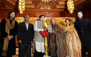 Minister of State for External Affairs Shashi Tharoor (centre) launches the '50 Maestros Recordings' with Sarod maestro Ustad Amjad Ali Khan (third from right), his wife Subalakshhmi (second from right), Sarod players Ayaan Ali Khan (left) and Amaan Ali Khan (right) and Ravi Puri of the India Today Group (second from left), in New Delhi on Monday. PTI